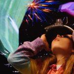 A kid looks through a virtual reality device
